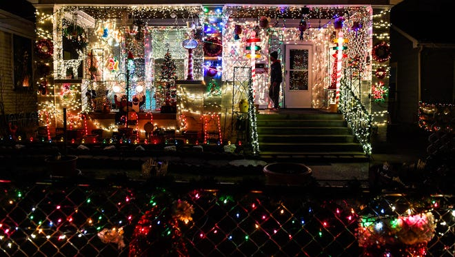 Wrapped in lights the house at 803 Jefferson Avenue glows with the Christmas spirit Tuesday, December 19, 2017.