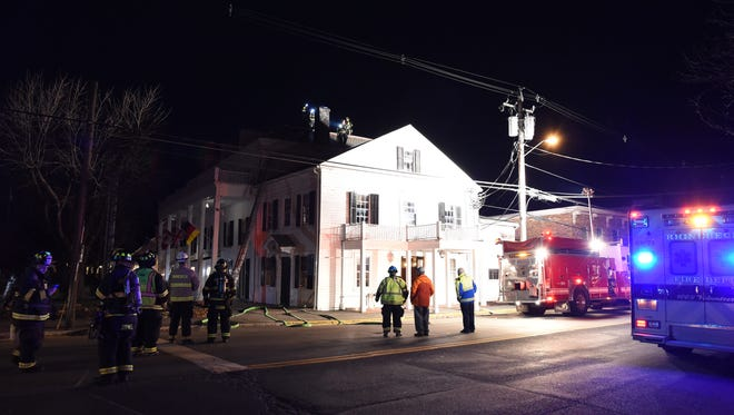 The Rhinebeck Fire Deparment responds to a chimney fire at the Beekman Arms in Rhinebeck on Friday night. Service was interrupted, and the building was evacuated, but the fire was quickly extinguished without any structural damage.