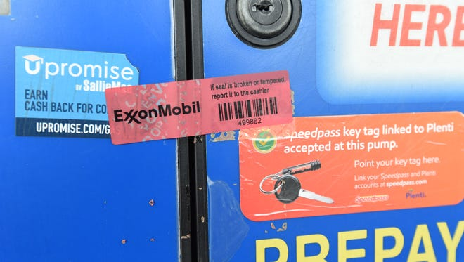 A red piece of tape placed over an access panel on a Mountain Home gas pump shows the access panel has not been compromised. Thieves have recently been breaking into these panels in Mountain Home and installing a credit card skimming device, according to Mountain Home Police.
