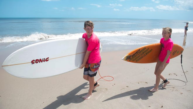 "Wyatt Dempsey (left), 12, and Lyndy Dempsey, 11, both of Fort Pierce, spent a few hours playing surfing following Hurricane Irma on Tuesday at Pepper Park Beachside on North Hutchinson Island in St. Lucie County. ""There's no one here and the waves are good,"" said their mother, Rebecca Dempsey. ""I was hoping the lifeguards would be out. We're being cautious."""