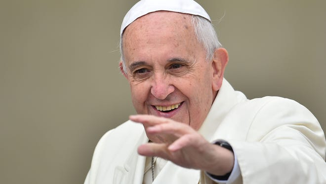 Pope Francis greets the crowd as he arrives for his general audience at St. Peter's Square on Oct. 29, 2014 at the Vatican.