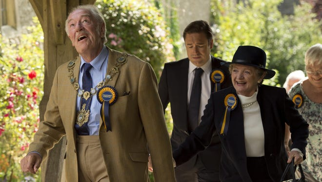 """Michael Gambon as Howard Mollison, left, Rufus Jones as his son Miles, and Julia McKenzie as his wife Shirley in a scene from the HBO television miniseries """"The Casual Vacancy"""" based on the novel by J. K. Rowling."""