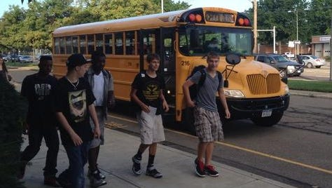 Students step off the buses during the first day of school at Union-Endicott High School.
