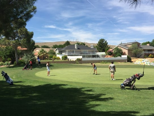 Golfers compete at the St. George Golf Club during