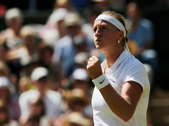 Petra Kvitova of Czech Republic celebrates winning a point against Lucie Safarova of Czech Republic during their women's singles semifinal match at the All England Lawn Tennis Championships in Wimbledon, London, Thursday, July 3, 2014. (AP Photo/Ben Curtis)