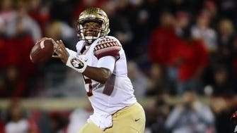 Quarterback Jameis Winston threw three interceptions, but he and Florida State rallied late for a 42-31 win.