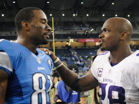 Detroit Lions wide receiver Calvin Johnson, left, and Minnesota Vikings running back Adrian Peterson meet after a game Oct. 25, 2015, in Detroit.