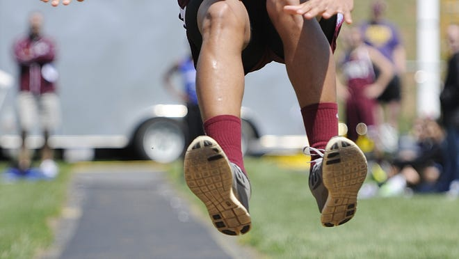 Stuarts Draft's Deonte Rohan competes in the triple jump during the Augusta County Invitational Track Meet on Saturday, April 26, 2014, in Greenville.