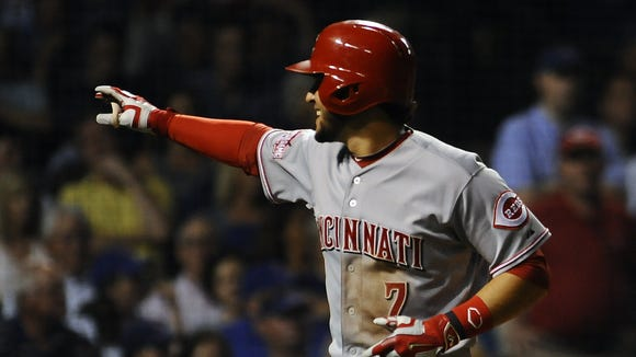 Cincinnati Reds shortstop Eugenio Suarez (7) homers in the seventh inning against the Chicago Cubs at Wrigley Field.