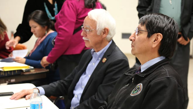 Former Navajo Nation Controller Jim Parris, left, and Navajo Nation Vice President Jonathan Nez listen to discussion on Wednesday during a special council session in Window Rock, Ariz.