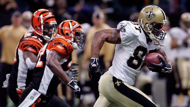 New Orleans Saints wide receiver Joe Horn (87) heads to the end zone after catching a pass against the Cincinnati Bengals  in the first half of their NFL football game in New Orleans, Sunday, Nov. 19, 2006. Giving Chase for the Bengals is Johnathan Joseph (22) and Madieu Williams (40).