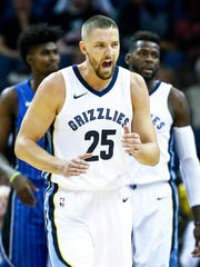 Memphis Grizzlies forward Chandler Parson (middle) celebrates a Orlando Magic turnover during first quarter action at the FedExForum in Memphis, Tenn., Wednesday, November 1, 2017.