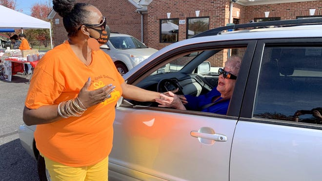 Florence McCorkle-Eury greets U.S. Navy veteran Chris Thornburg at the Remembering Our Veterans event in downtown Gastonia hosted by Risa's Special Delivery.