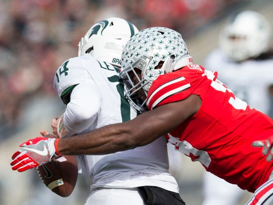 Nov 11, 2017; Columbus, OH, USA; Ohio State Buckeyes defensive lineman Tyquan Lewis (59) knocks the ball away from Michigan State Spartans quarterback Brian Lewerke (14) during the first half at Ohio Stadium.
