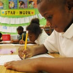 Terrell Pegues works on math at Mansfield Elementary School.