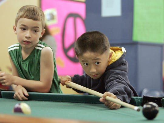 Children play pool at the Boys & Girls Club of the Fox Valley.