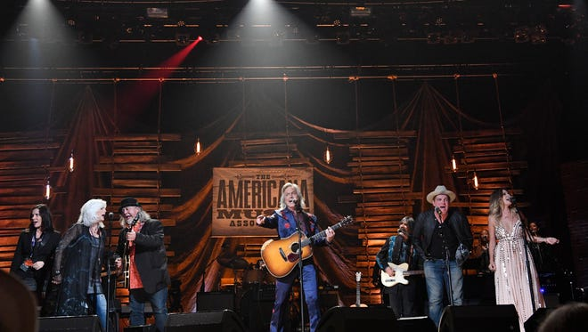 """Jim Lauderdale performs """"Tulsa Time"""" with a group of artists for the finale at the Americana Music Honors & Awards 2017 Wednesday, Sept. 13, 2017 at the Ryman Auditorium in Nashville, Tenn."""