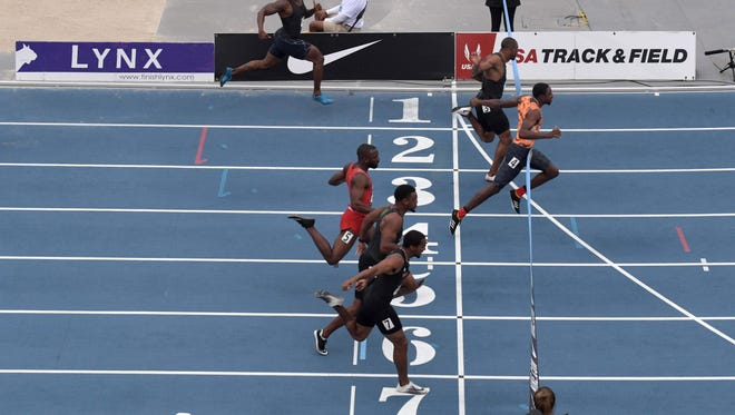 Noah Lyles (4) defeats Ronnie Baker (3) to win the 100m, 9.89 to 9.90 during the USA Championships at Drake Stadium.  From bottom: Kendal Williams of Georgia (7), Isiah Young (6), Cameron Burrell (5), Lyles, Baker, Bryce Robinson (2) and Jeff Demps (1).