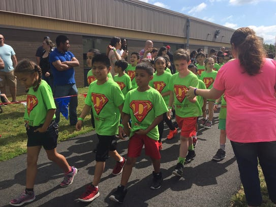 Green shirts marked second-graders taking part in Friday's