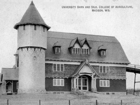 The original part of the dairy barn on the University of Wisconsin campus in Madison featured in this old postcard, was designed by J.T.W. Jennings to recall historic barns in Normandy and was built in 1897-1898.