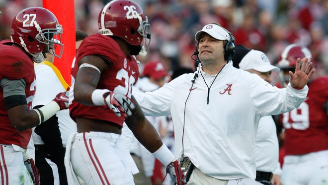 Nov 15, 2014; Tuscaloosa, AL, USA; Alabama Crimson Tide defensive coordinator Kirby Smart talks to his defense during the game against the Mississippi State Bulldogs at Bryant-Denny Stadium. Mandatory Credit: Marvin Gentry-USA TODAY Sports