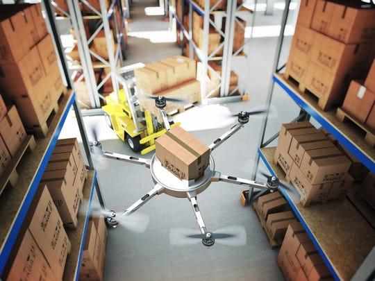 A drone works in classic warehouse with the help of a robot.