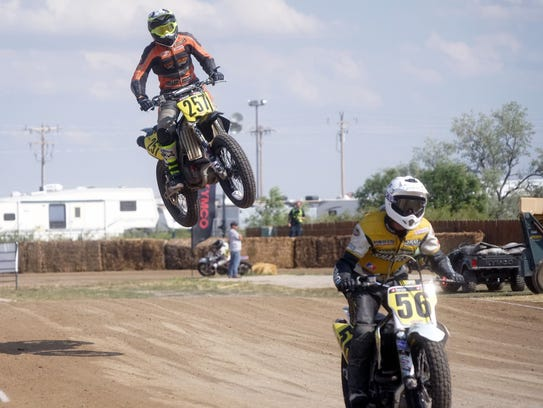 A flat-track racer flies over a jump at Buffalo Chip