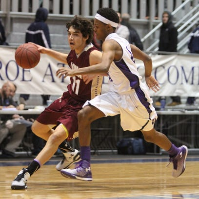 Iona Prep's Ty Jerome moves the ball around New Rochelle's