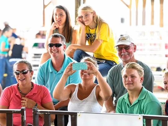 Spectators and family of the competitors attend the