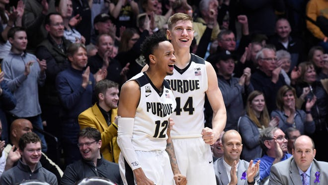 Purdue Boilermakers forward Vincent Edwards (12) and center Isaac Haas (44) celebrate in the second half against the Minnesota Golden Gophers at Mackey Arena.