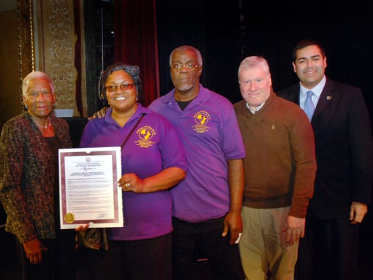 "Union County Freeholder Vice Chairman Sergio Granados (right) and Freeholder Vernell Wright (left) presented a resolution to Ken and Charlotte Brown of United Youth of New Jersey (UYNJ) in honor of Dr. Martin Luther King Jr. Day before the theater company's production of ""MLK: THE NIGHTMARE AFTER THE DREAM"" at the Union County Performing Arts Center in Rahway. They were joined by County Manager Alfred Faella (second from right)."
