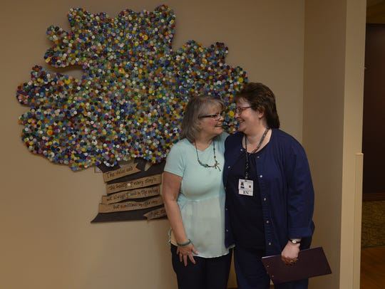 Debbie Nickel, left, shares a smile with her oncology