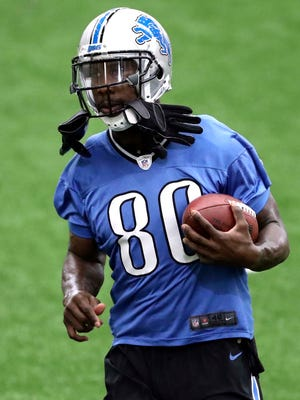 Lions wide receiver Anquan Boldin (80) jogs with the ball during practice on Friday.