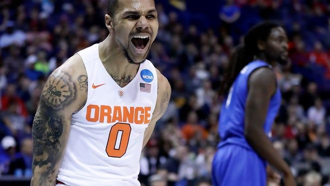 Syracuse's Michael Gbinije celebrates after making a basket.