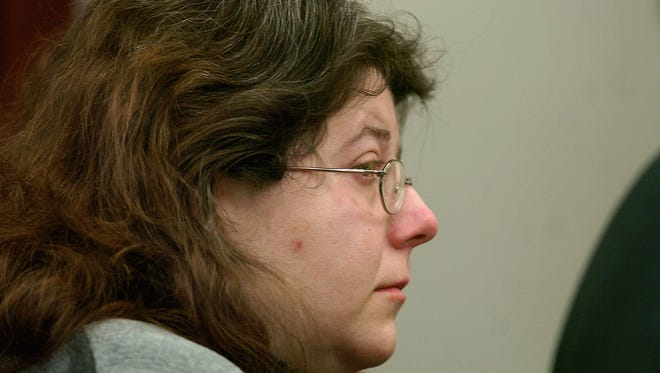 Facing life in prison: Lisa Holland, 33, listens as a Lansing jury announces Friday October 27, 2006, two guilty verdicts against her in the July 2005 death of her adopted 7-year-old son Ricky.