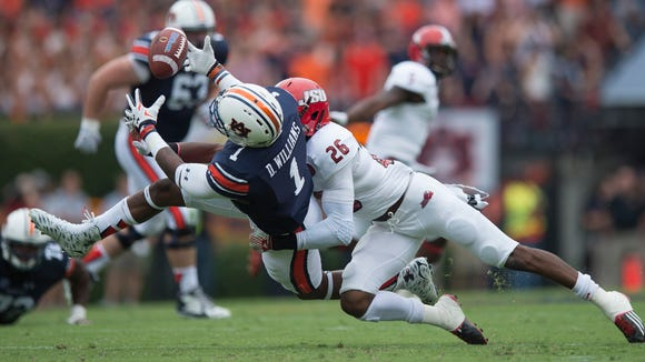 Auburn Tigers wide receiver D'haquille Williams (1) drops a pass as Jacksonville State Gamecocks safety Santavious Oden (26) hits him during the first half of the NCAA Auburn vs. Jacksonville State on Saturday, Sept. 12, 2015, in at Jordan-Hare Stadium in Auburn, Ala.Albert Cesare / Advertiser