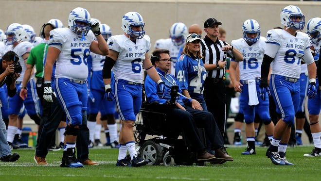 Kreg Palko was chosen as an honorary captain representing Air Force took part in the coin toss before the Michigan State game on Saturday, September19, 2015 at Spartan Stadium in East Lansing Michigan. His wife Elizabeth Palko accompanied him onto the field.