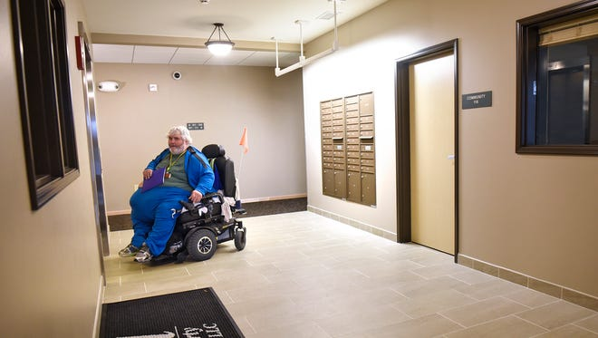 Veteran Mark Schotl uses the elevator to make is way to his new home n the Linden Grove apartments after moving in Monday, Oct. 31, in St. Cloud.