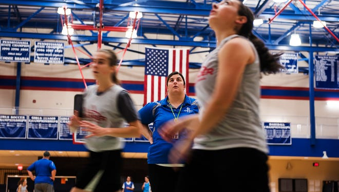 Spring Grove girls' basketball head coach Holly Strait works with her team during drills Wednesday night Nov. 30, 2016 at Spring Grove High School.