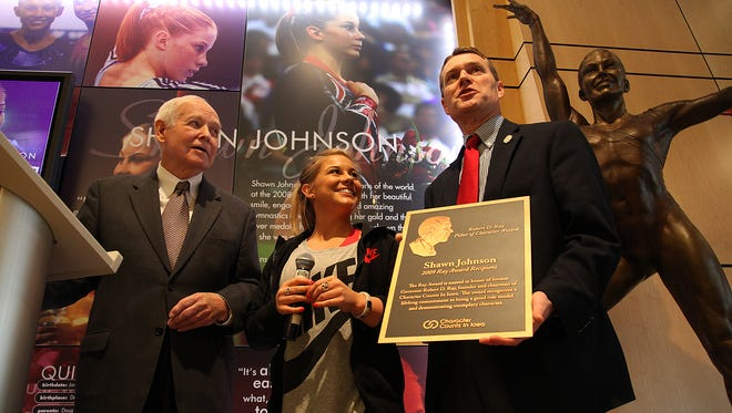 Olympic champion Shawn Johnson, center, is presented with the Robert D. Ray Pillar of Character Award by former Iowa Gov. Robert Ray, left, and Character Counts in Iowa executive director Scott Raecker in 2009.