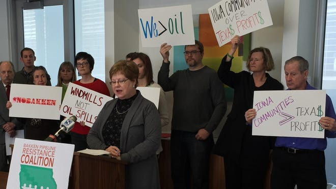 Arlene Bates, who owns farmland in Story County, speaks against the proposed Bakken pipeline at a news conference in February in Des Moines.