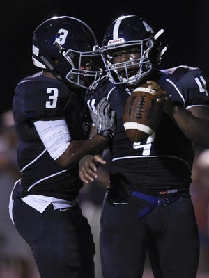 Siegel wide receiver D'aundre McMillan (3) congratulates running back Rodney Murray (4) after his touchdown in the second quarter against Ravenwood at Siegel High School Thursday.