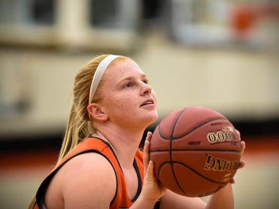 Kelsey Kline concentrates on a free throw during practice
