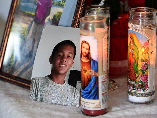 A photo of Devin Minus, 14, sits on a memorial table