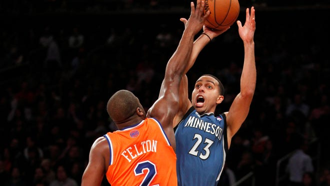 Timberwolves shooting guard Kevin Martin shoots as Knicks point guard Raymond Felton defends in the first quarter at Madison Square Garden.