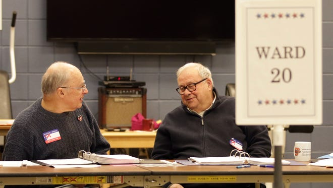 Poll workers Robert Presten, left, and Richard Burchinal converse while waiting for people to vote in the Wisconsin State Supreme Court election being held Tuesday at the Senior Activity Center in Sheboygan.