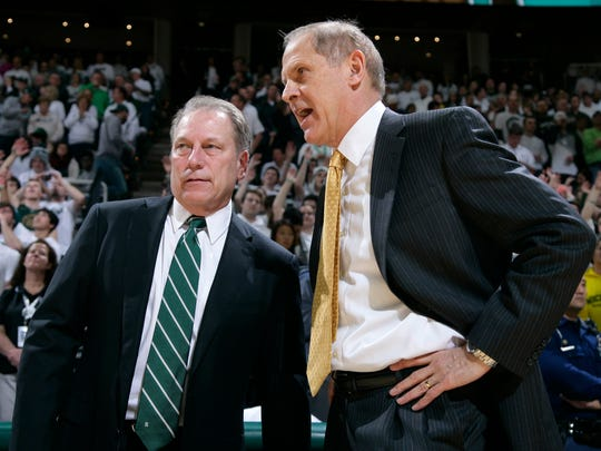Michigan State coach Tom Izzo, left, and Michigan coach John Beilein will meet March 9 at the Breslin Center in East Lansing. This game between the intrastate rivals could determine who wins the Big Ten title.