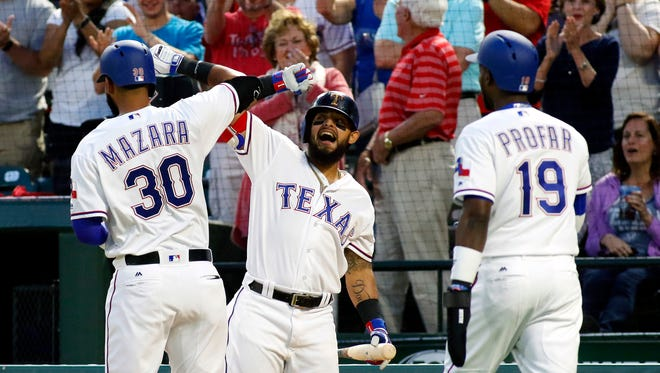 Nomar Mazara, left, is greeted by Rangers teammate Rougned Odor after his grand slam in the second inning against the Athletics at Globe Life Park in Arlington, Texas.