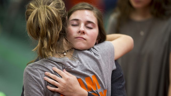 Well-wishers hugged Sunday during a memorial service for Brody Stephens, at the New Palestine High School gym,