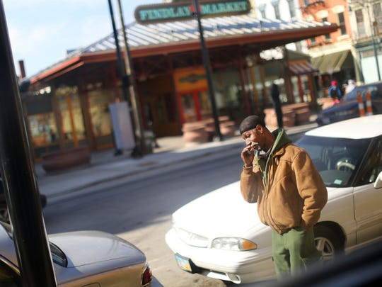 Jerome Burton, 50, takes a smoke break outside of Our